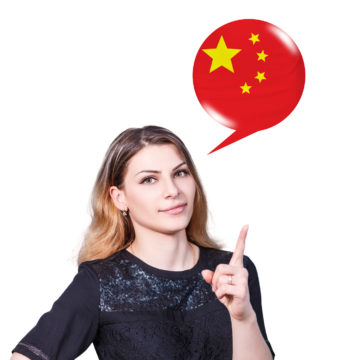 Young woman point on the bubble with german flag. Learning of foreign languages concept.